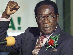 """Zimababwe's President Robert Mugabe chants Zanu PF slogans with supporters gathered at the Harare International Conference Centre in Harare, Wednesday May 3, 2000. Mugabe launched the Zanu PF's election manifesto which bears the slogan """"Land is the Economy and the Economy is Land"""". (AP Photo/Christine Nesbitt)"""