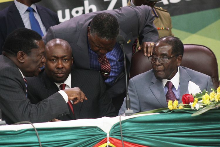 President Mugabe speaks to Vice President Emmerson Mnangagwa while Vice President Phelekezela Mphoko and Secretary for Commissariat Saviour Kasukuwere looks on at Women's league National Assembly meeting in Harare yesterday. Picture by Justin Mutenda